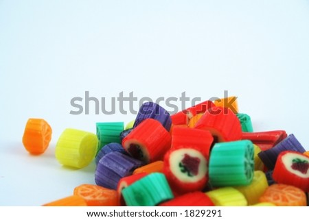 Coloured sweets on a white background