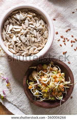 Colourful and healthy crunchy mixed seeds and various sprouts. - stock photo