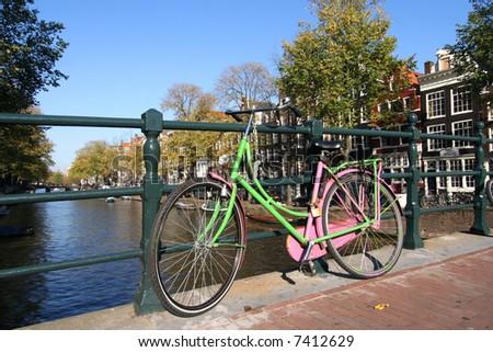Colourful bicycle on an Amsterdam bridge - stock photo