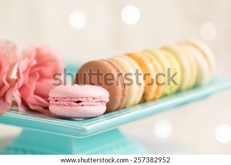 Colourful biscuits, macaroons isolated against a light background - stock photo