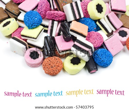 Colourful candy and liquorice on a pure white background with space for text