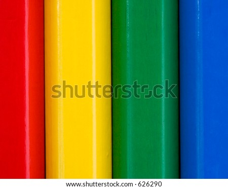 Colourful close up vertical pattern of childrens pencils.