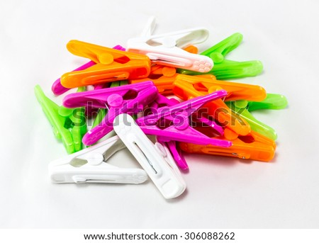 colourful clothespins on white background - stock photo