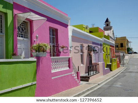 Colourful cottages in a street in Bo Kaap, formerly known as the Malay Quarter, in Cape Town. - stock photo