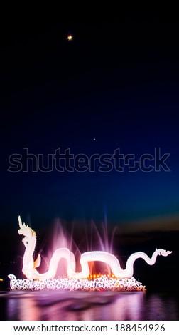 Colourful Dragon on warter twilight - stock photo