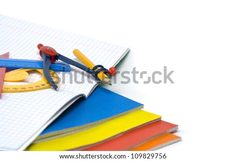 Colourful exercise books and other school supplies