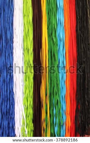 Colourful fabric lanyards - stock photo