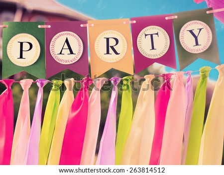 Colourful festive swag banner with ribbons for party decoration - stock photo