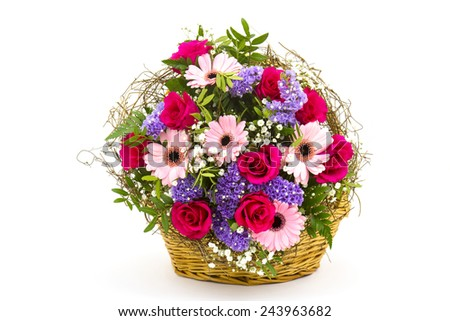 colourful flowers in a basket on white background - stock photo