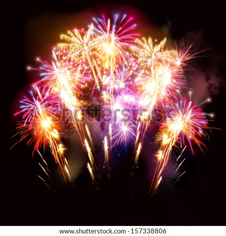Colourful golden and pink fireworks display for celebrations. - stock photo