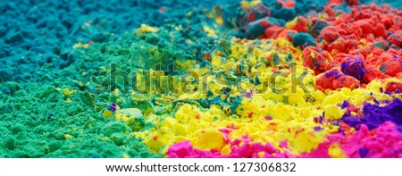 Colourful Gulal (focus at the middle of the frame) - stock photo