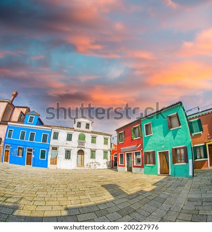 Colourful homes - Blue, white, red, green buildings at sunset - stock photo