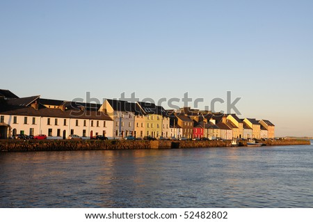Colourful houses at dusk on Ballyknow Quay, Galway, Republic of Ireland - stock photo