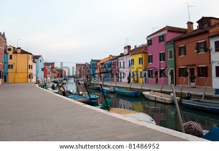 Colourful houses at sunset on Burano - stock photo