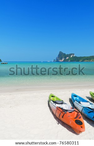 Colourful kayaks on the beach. Phi Phi island. - stock photo