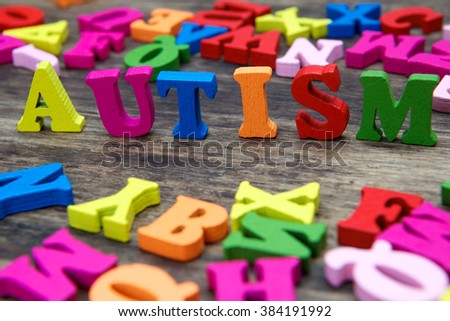 Colourful letters spelling out Autism  - stock photo
