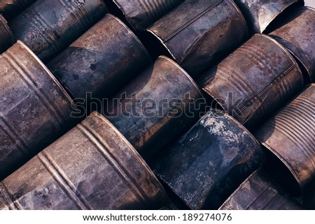 colourful lying rusty cans - stock photo