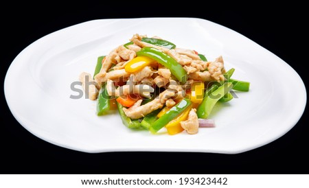 Colourful meat and vegetable stir-fry being cooked  isolated on black background , chinese cuisine - stock photo