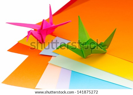 Colourful origami birds and paper - stock photo