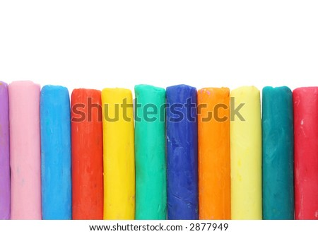 Colourful plasticine pieces isolated on white - stock photo