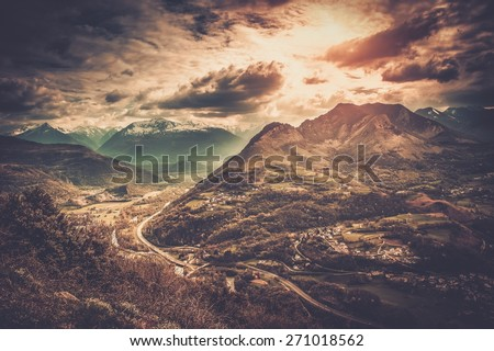 Colourful sky over Pyrenees mountains - stock photo