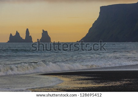 Colourful sky - sunset over the Dyrholaey rock. Vik, Iceland. - stock photo