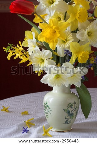 Colourful spring. Bouquet of flowers of on a table in a living room - stock photo