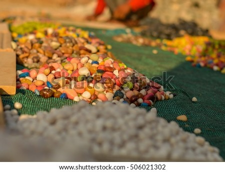Colourful stones for sale at a road side shop in New Delhi, India.