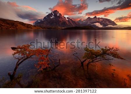 Colourful sunrise over Cerro Paine Grande, Torres del Paine, Chile - stock photo