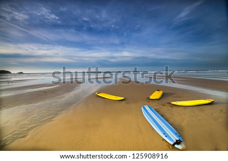 Colourful Surf Boards on Fistral  Beach Newquay Cornwall England - stock photo