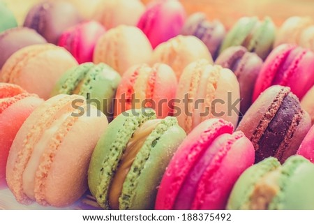 Colourful tasty macaroons in a row - stock photo