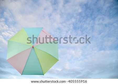 Colourful umbrella ,sweet color on sky  background