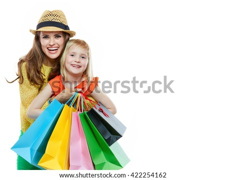 Colourful vibes of family shopping. Portrait of happy mother hugging daughter with shopping bags on white background - stock photo