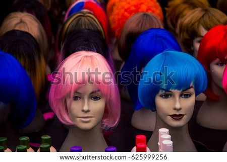 colourful wigs on a mannequins head