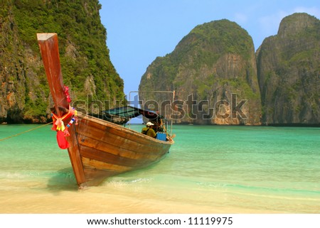 "Colourfully decorated boat at Maya Bay: an idyllic beach on Phi Phi Ley - the scene of the film ""The Beach"". - stock photo"