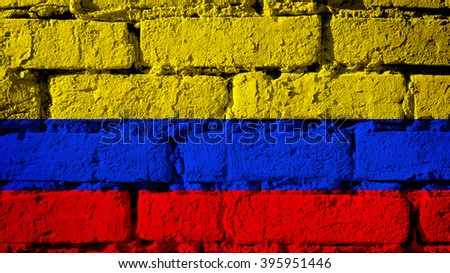 Columbia flag on a brick wall