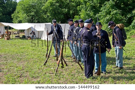 COLUMBIA, PA-JUNE 29: Union officer inspecting troops at the Civil War encampment at Columbia on June 29, 2013.  Columbia celebrates the 150th anniversary of its role in the Civil War. - stock photo