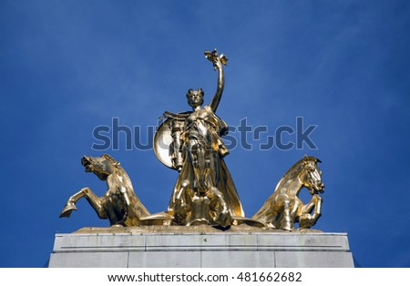 Columbia Triumphant leading a seashell chariot of three seahorses on top of USS Maine monument in Central Park NYC.