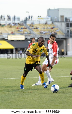 COLUMBUS, OH - JULY 7: Concacaf Gold Cup from Crew Stadium. Jamaica's Omar Cummings moves into the Cosa Rica penalty area. July 7, 2009 Columbus, OH - stock photo