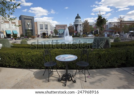 COLUMBUS, OHIO - OCTOBER, 8, 2014:  Easton Town Center in Columbus, Ohio is anchored by Macy's and Nordstroms and includes an additional 240 other retail shops.   - stock photo