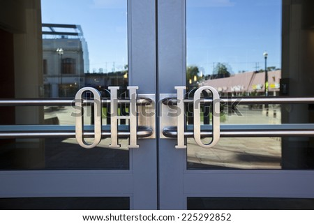 COLUMBUS, OHIO-OCTOBER 12, 2014:  The unique design of the door handles leading into the Ohio Union on the Ohio State University campus shows the attention to detail included in this building. - stock photo