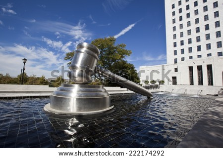 COLUMBUS, OHIO-SEPTEMBER 27, 2014: The Gavel Sculpture in downtown Columbus sits in the reflecting pool alongside of the Supreme Court of Ohio building.   - stock photo