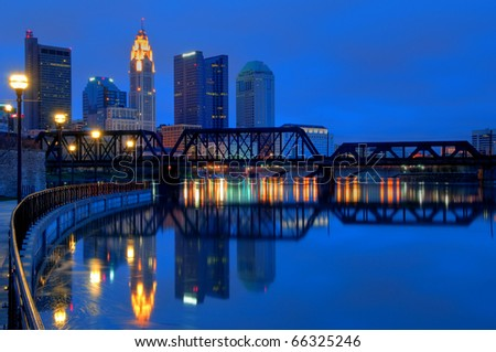 Columbus Ohio Skyline at Night:  A view of Columbus, Ohio�s cityscape overlooking the Scioto River at night. - stock photo