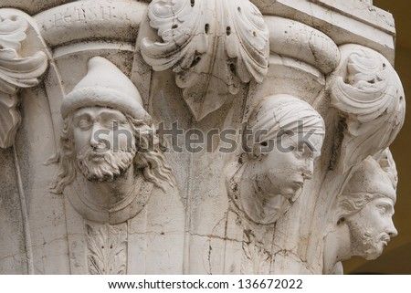 Column capital at Doge's Palace in Venice shows architectural details of people from various cultures
