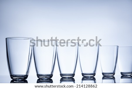 column of empty water glasses