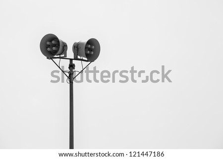 Column with a pair of speakers - stock photo