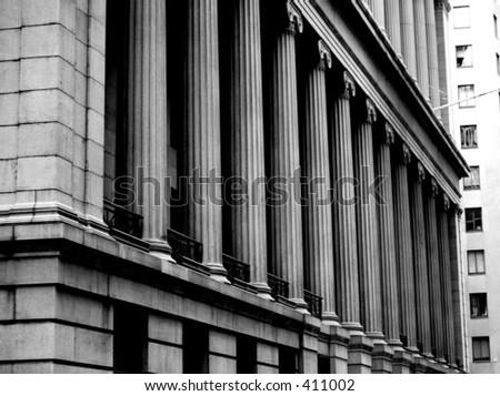 columns along Wall Street in New York - stock photo