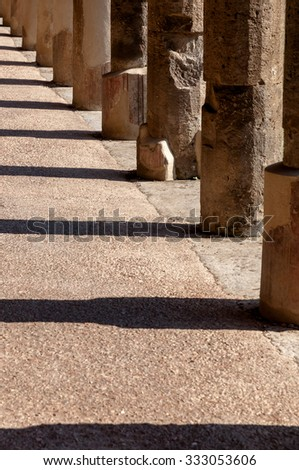 Columns and its shadows in a corridor at stabian baths in Pompeii . Pompeii was destroyed and buried with ash and pumice after Vesuvius eruption in 79 AD. - stock photo