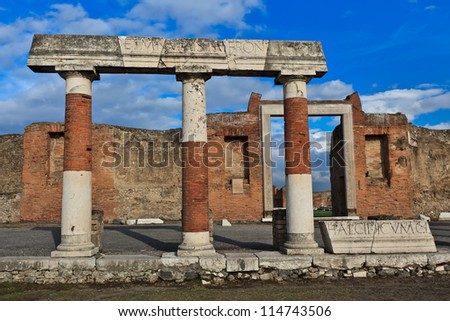 Columns and ruins of Pompeii , which was destroyed and buried during the eruption of Mount Vesuvius in 79 AD - stock photo