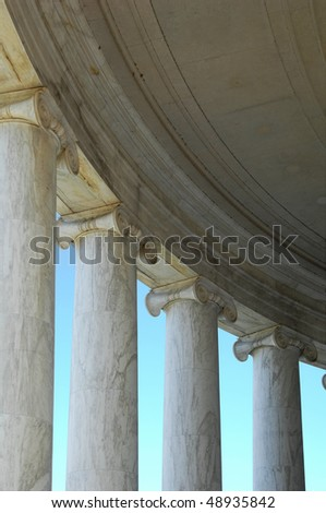 columns, capitals and dome of the Jefferson Memorial - stock photo